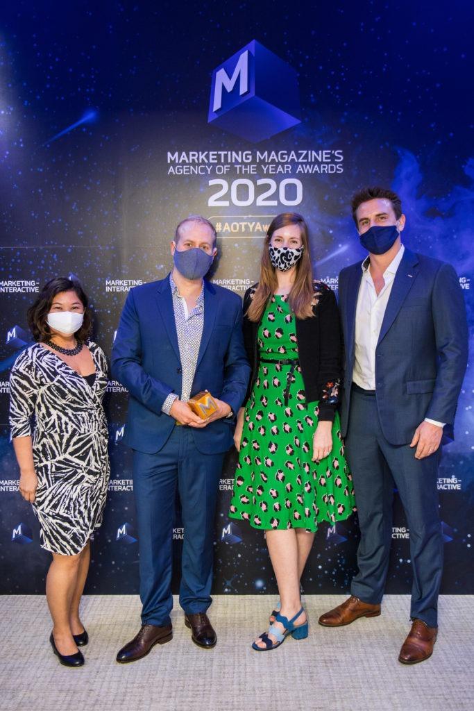 Kadence team collecting Agency of the Year award